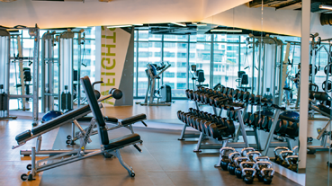 gym at the acqua private residences
